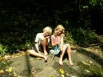 kids on rock near creek